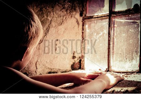 Poor Shirtless Child Near Window