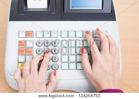 Cash Register with hands of woman isolated