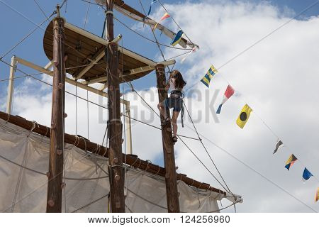 Tall ship sails and masts fragment - top of the mast with flags