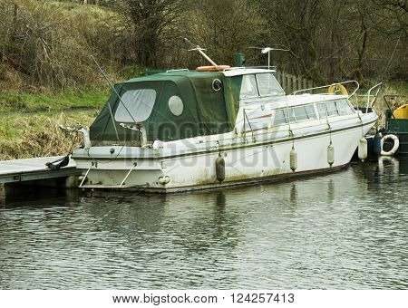 an image of an old motor boat in need of cleaning and restoration