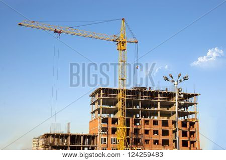 construction of residential brick house with gantry crane