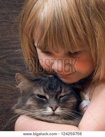 Portrait of a teen girl with a cat. The girl smiles. The face and muzzle close ** Note: Visible grain at 100%, best at smaller sizes