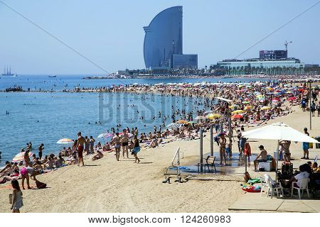 SPAIN, BARCELONA, JUNE, 27, 2015 - Barceloneta beach of hot summer day in Barcelona, Spain