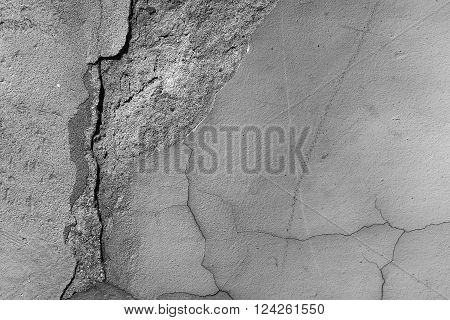 Cement wall cracked fine smooth surface premixed layer fracture grunge aged look on concrete background