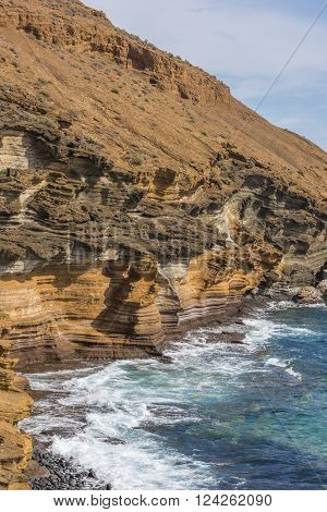 Steep rocky shore on the South-West of Tenerife. Steep rocky shore on the South-West of Tenerife.
