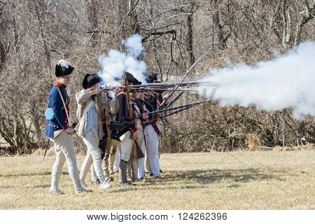 VALLEY FORGE PA - FEBRUARY 18, 2012: Revolutionary War soldiers fire muskets at a reenactment in Valley Forge National Historic Park