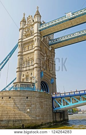 London, UK - April 30, 2011: Fragment of Tower Bridge over River Thames in London UK. Tower Bridge is a suspension and bascule bridge in London of the UK. It crosses the Thames River and has become an iconic symbol of London.
