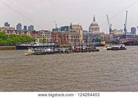Northern Bank of River Thames with St Paul Cathedral in London UK. Saint Paul Cathedral is an Anglican church the seat for the Bishop of London. It is one of the most famous London sights.