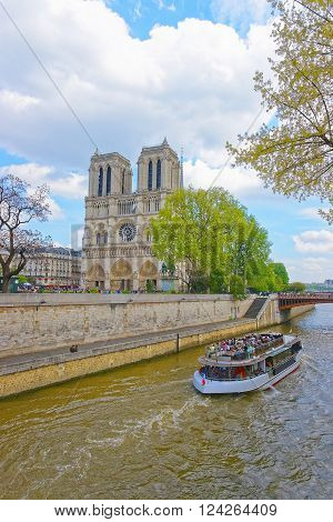 PARIS FRANCE - MAY 3 2012: Notre Dame de Paris Cathedral and Seine River in France. It is french for Cathedral of Our Lady in Paris. It is one of the most known churches in the world.