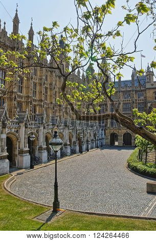 Palace of Westminster in London the UK. It is a meeting place of the House of Lords and the House of Commons the two houses of the UK Parliament.