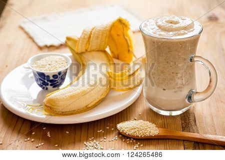 White sesame seeds and banana smoothie. Sweet banana and sesame seeds.