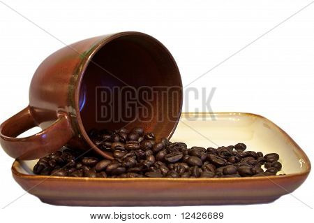 Coffee Beans Spilling From Cup