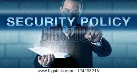 CISO with a critical look across his glasses is pushing SECURITY POLICY on a visual screen. Business challenge metaphor and information technology concept network protection standards and procedures.