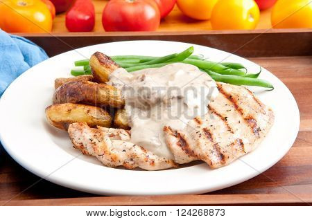 bbq chicken breast with creamy mushroom sauce and fingerling potatoes