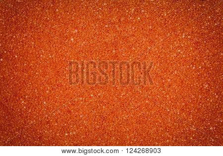 Orange spongy porou rough macro texture background