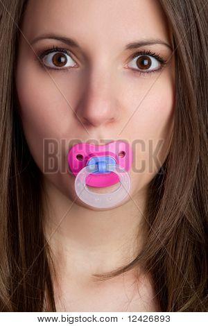 Beautiful young woman sucking pacifier