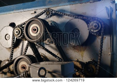 At sawmill. Image of rotating gears on running machine