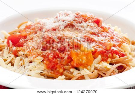 vegetarian whole wheat pasta with heirloom tomato sauce