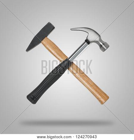 Crossed hammer and sledgehammer. Tools for carpentry work.
