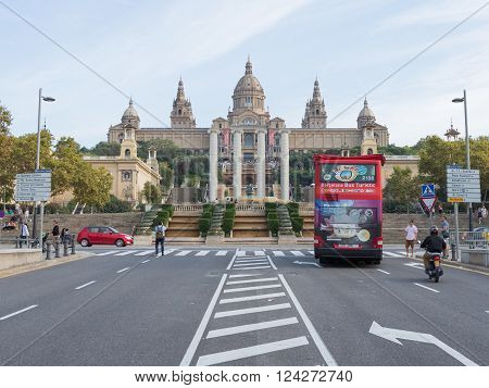 Barcelona - 10 October 2015: Avenue Queen Maria Cristina tourist bus and people walk in front of the Museum of Catalonia October 10 2015 Barcelona ??Catalonia Spain