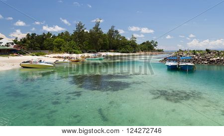 La Digue - 10 November 2014: The boats of fishermen are the beautiful sandy beaches and people are going to go fishing on a sunny day November 10 2014 the island of La Digue Seychelles