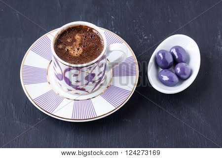 Turkish coffee and sugar coated coffee on a black background