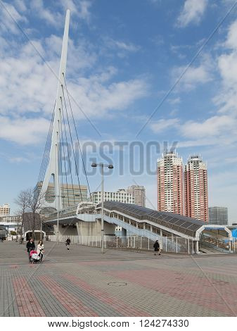 Tokyo - 7 February 2015: The new modern district of Tokyo - Odaiba and beautiful park with paved walkways and unusual pedestrian crossing