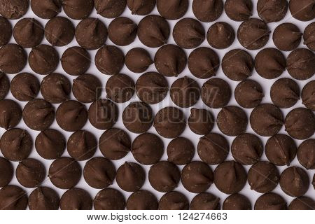 Looking down on rows of milk chocolate chips.