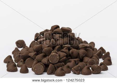 A large pile of milk chocolate chips.