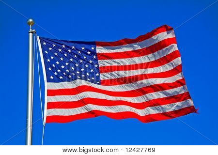 United States of America flag flying on flagpole.