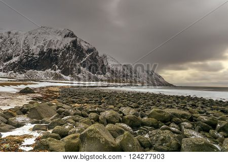 Scenic pebble beach in Eggum Lofoten Islands Arctic Norway Scandinavia Europe on a cloudy winter day. ** Note: Soft Focus at 100%, best at smaller sizes