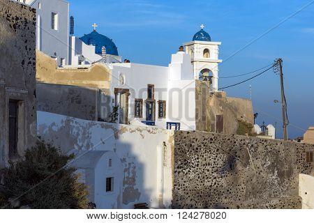 White house and churches in town of Imerovigli, Santorini island, Thira, Cyclades, Greece