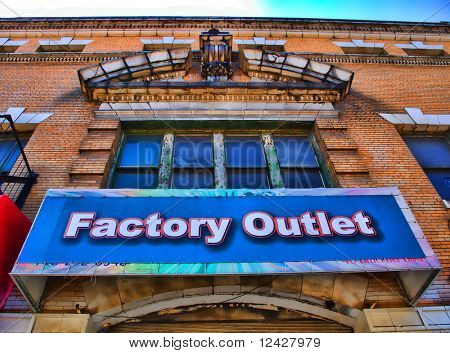 View of sign on a factory outlet residing within an historic and beautiful building.