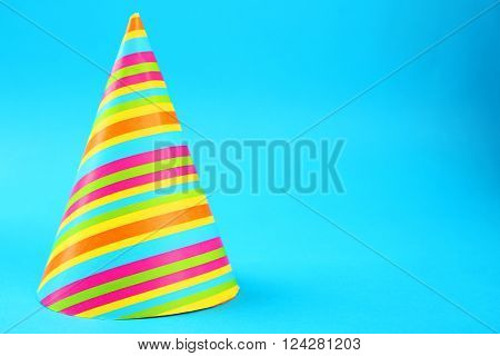 Striped Birthday hat on blue background