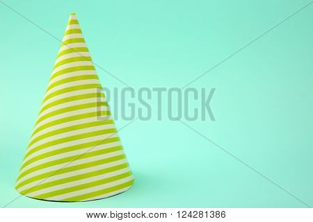Striped Birthday hat on light blue background
