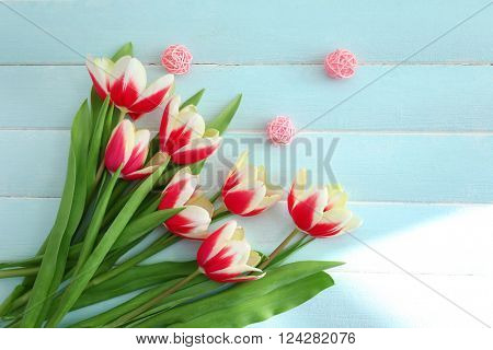 Bouquet of variegated tulips on blue wooden background