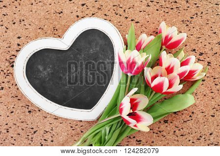Bouquet of variegated tulips with frame on pin board
