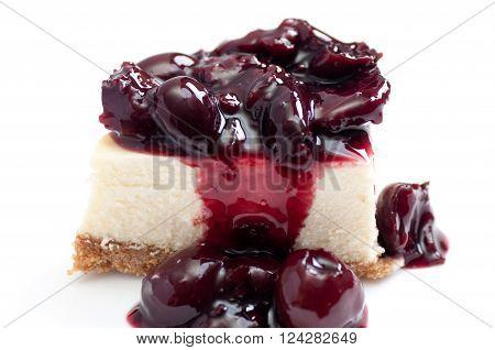 organic cherries on top of creamy new york style cheesecake for dessert stock photo