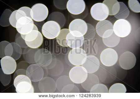 Sparkles and defocused white lights background. Real lens bokeh or blur.