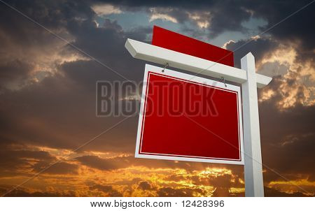 Blank Red Real Estate Sign Over Sunset Sky Ready For Your Own Message.