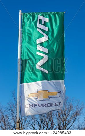 SAMARA RUSSIA - MARCH 20 2016: Niva Chevrolet dealership sign against blue sky. Chevrolet is a American automobile manufacturer
