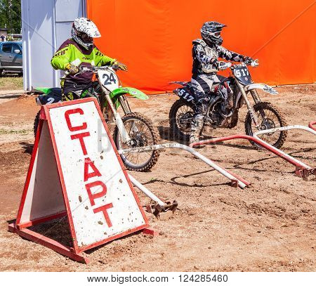 BOROVICHI RUSSIA - JULY 11 2015: Motocrossers in the starting line waiting for race to start