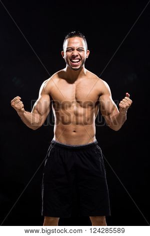 Furious man screaming shirtless on Black Background