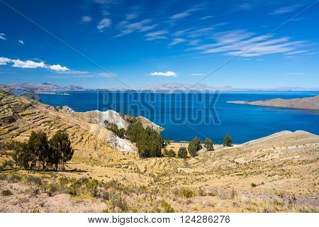 Panoramic view from the Island of the Sun towards the Yampupata Peninsula on the majestic Titicaca Lake among the most scenic travel destination in Bolivia.