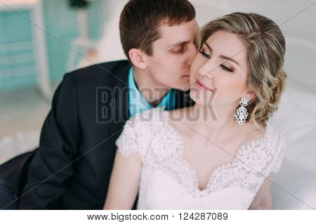 Happy Couple. Wedding Photo Shoot In The White Studio With Wedding Decor Kisses, Hugs