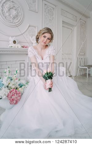 Portrait of bride in flower decor studio photo. Beautiful Bride portrait wedding makeup and hairstyle fashion bride model jewelry and beauty girl face gorgeous beauty bride studio flower series
