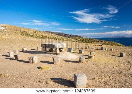 Wide angle view of the Inca's sacrifice table with majestic rural landscape on Island of the Sun Titicaca Lake among the most scenic travel destination in Bolivia. Travel adventures and vacations in the Americas.