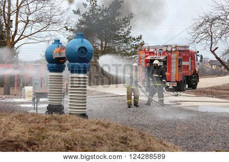 IVANGOROD, LENINGRAD OBLAST, RUSSIA - MARCH 29, 2016: Fire fighting during the emergency training at Narvskaya Hydroelectric Power Plant. Built in 1956, it has nameplate capacity 125 MW