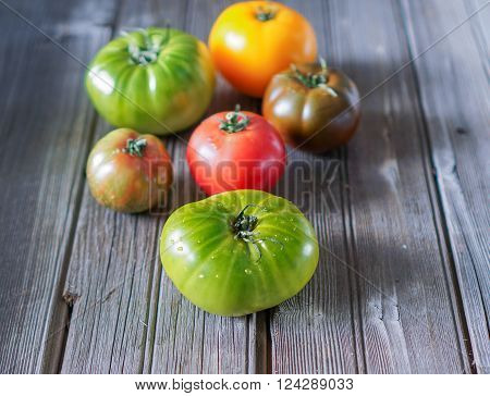 Heirloom Tomatoes on Wood Background. Selective Focus.