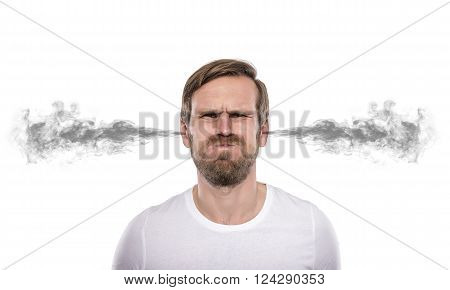 Stressful man with smoke or fume coming out from his ears isolated on white background.